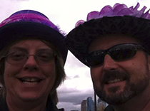 NEREG team members all decked out in purple