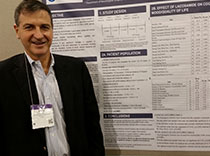 Dr. Marcelo Lancman standing next to his poster on Vimpat