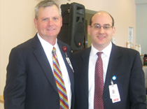 Joseph F. Scott, President and CEO of Liberty Health and Dr. Fertig