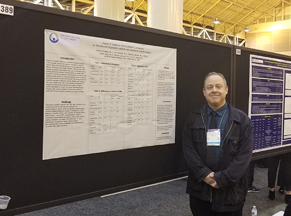 Dr. Robert Trobliger next to his poster on Epidiolex and cognition
