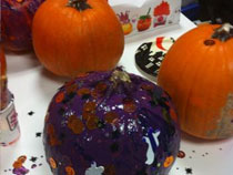 Two pumpkins waiting for their purple make over.
