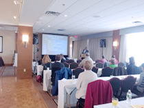 Dr. Arno Fried speaks to a room of nurses and parents
